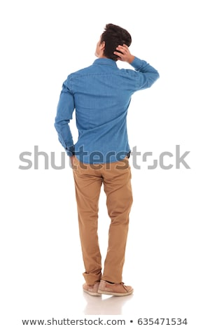 rear view of   man looking to side while scratching  head Stock photo © feedough