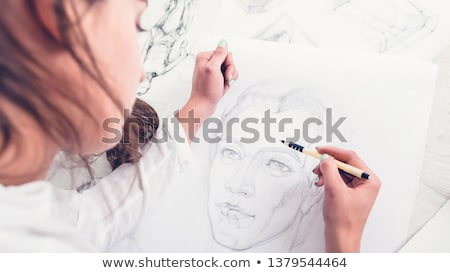 Cropped image of a young woman artist drawing sketches Stock photo © deandrobot