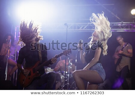 Female singer with male guitarist performing together at nightclub Stock photo © wavebreak_media