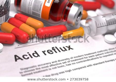 peptic ulcer   printed diagnosis on red background stock photo © tashatuvango