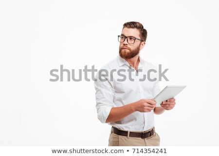Picture of serious businessman standing with tablet Stock photo © Traimak