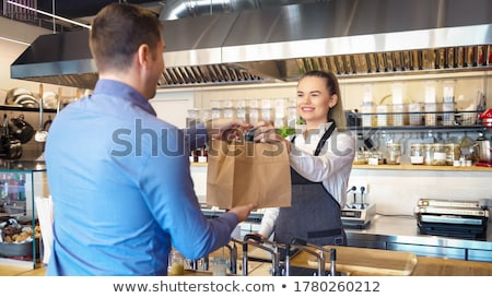 Waitress wearing a apron in restaurant Stock photo © wavebreak_media