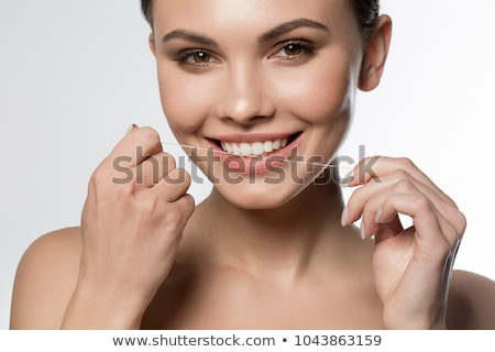 Stock photo: Woman flossing teeth