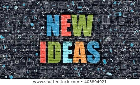 New Ideas Concept. Multicolor on Dark Brickwall. Stock photo © tashatuvango