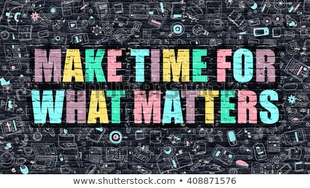 Make Time for What Matters on Dark Brick Wall. Stock photo © tashatuvango