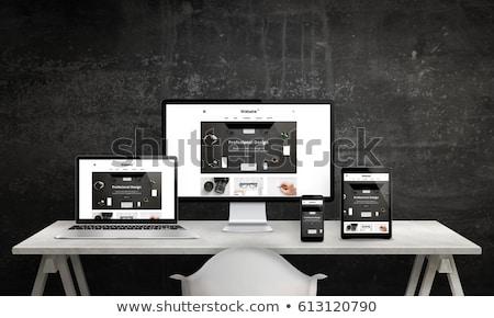 clean code on laptop in modern workplace background stock photo © tashatuvango