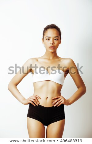 Portrait of a half of slim female body in underwear Stock photo © deandrobot