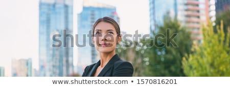 Aspiring lady executive  looking up Stock photo © palangsi