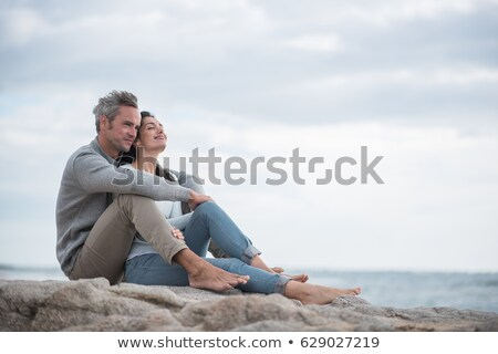 Middle aged couple on rocks portrait Stock photo © IS2