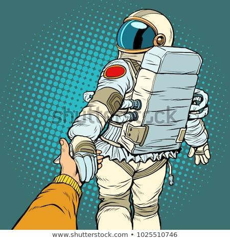 astronaut space travel follow me concept, couple love hand leads Stock photo © studiostoks