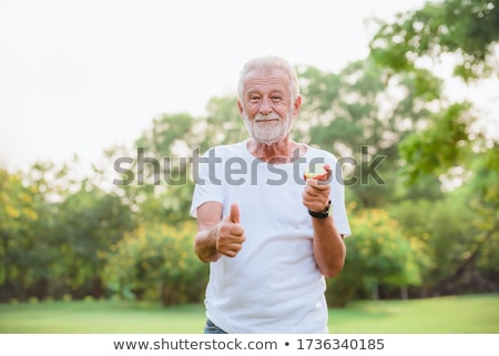 Older man eating at family picnic Stock photo © IS2