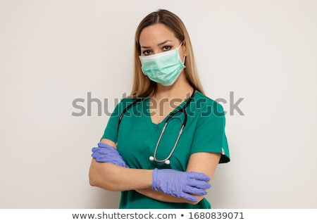 Portrait of nurse standing with arms crossed Stock photo © wavebreak_media
