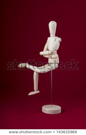 Wooden figurine sitting with hand on head Stock photo © wavebreak_media