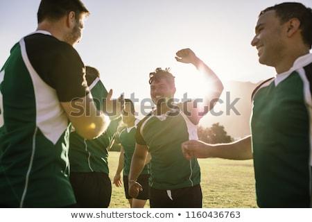 Hombres jugando rugby hombre ejecutando estadio Foto stock © IS2