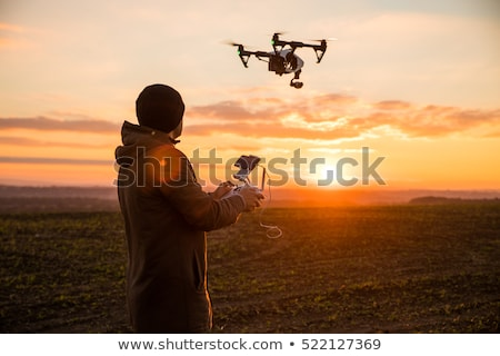 man playing with a multicopter Stock photo © unkreatives