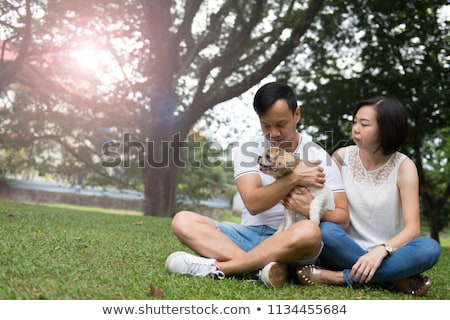 Asian couple chien animal chiot extérieur Photo stock © kenishirotie