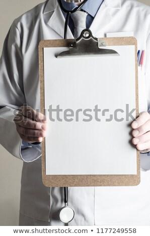 医師 クリップボード シート 紙 向い ストックフォト © frannyanne