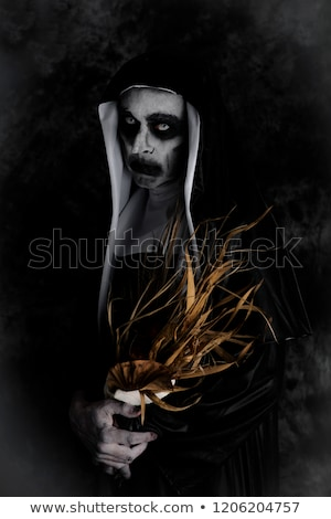 spooky evil nun with a dry bouquet of flowers Stock photo © nito