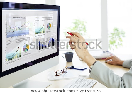 Businesswoman works with computer mouse Stock photo © Traimak