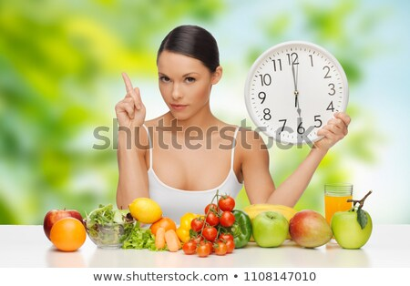 woman with food and clock showing six Stock photo © dolgachov