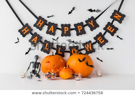 halloween decorations candies and carved pumpkins stock photo © dolgachov