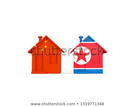 Two houses with flags of China and north korea Stock photo © MikhailMishchenko