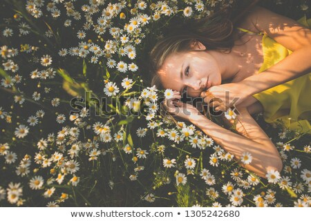 Portrait of young  woman with radiant clean skin lying down amid Stock photo © lightpoet