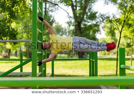 Adult Man Training ABS Abdominals Muscles Doing Calisthenics Outdoors Stock photo © diego_cervo