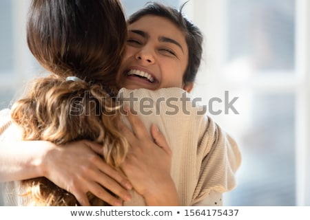 close up of two cheerful young girls students stock photo © deandrobot