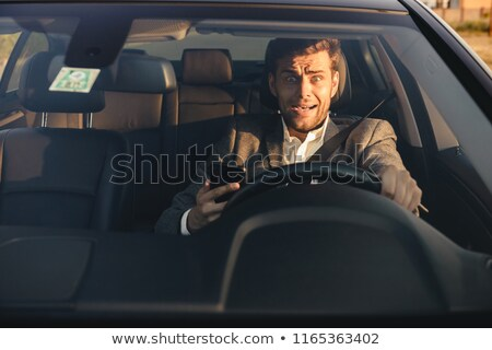 portrait of a scared young business man stock photo © deandrobot