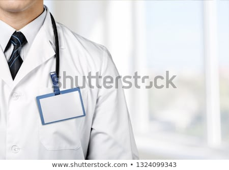 doctor with stethoscope and permit stock photo © vladacanon