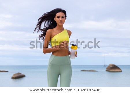 Fitness Woman Holding Protein Shaker Bottle Stock photo © AndreyPopov