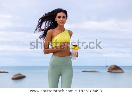 Фитнес-женщины белок шейкер бутылку портрет Сток-фото © AndreyPopov