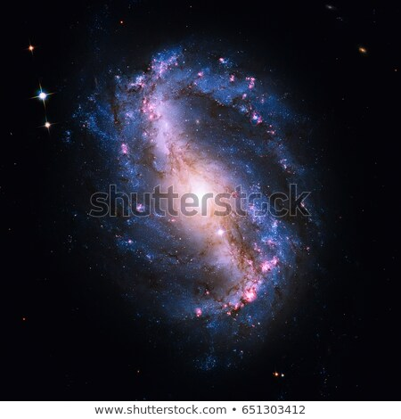 NGC 6217 is a spiral galaxy in the constellation Ursa Minor. stock photo © NASA_images