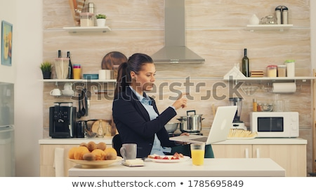 thoughtful woman while having breakfast stock photo © kzenon