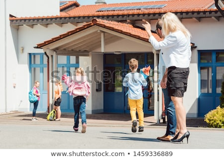 Woman and kids at enrollment day with school cones Stock photo © Kzenon