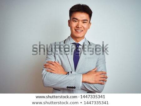 Portrait of a boy in front of a gray background Stock photo © Lopolo