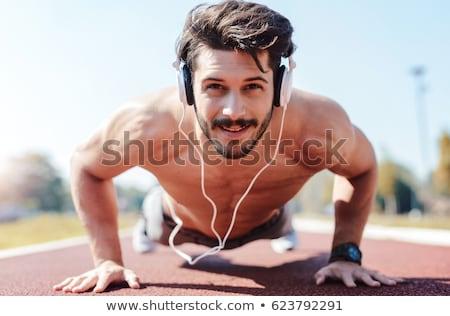 やる気のある 小さな フィット スポーツマン 音楽を聴く イヤホン ストックフォト © deandrobot