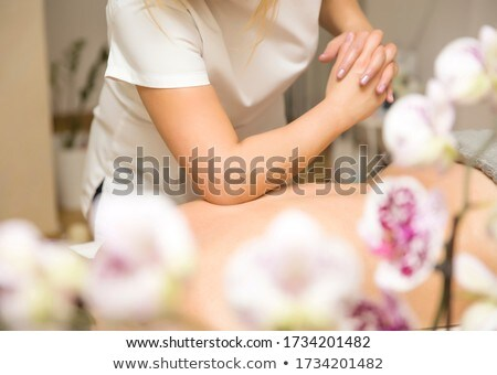 Woman having an elbow technique massage Stock photo © boggy