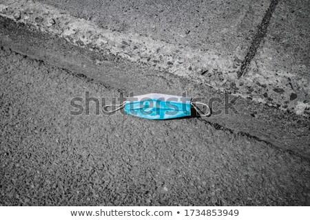 Usado máscara cirúrgica asfalto azul rua Foto stock © nito