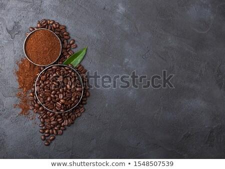 Cup fresche greggio chicchi di caffè terra Foto d'archivio © DenisMArt