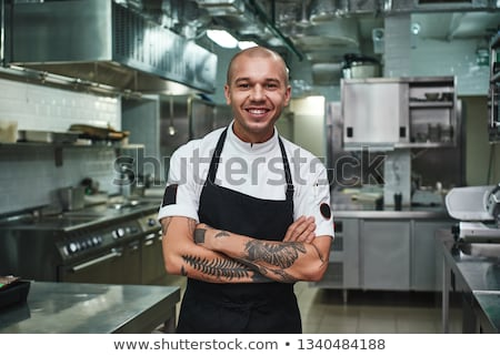 Portrait of young male chef in commercial kitchen Stock photo © dacasdo