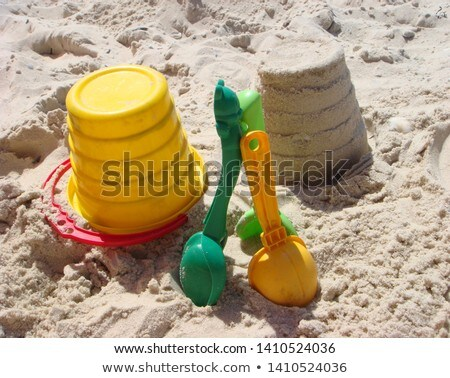 Close up of red childs spade on sandy beach Stock photo © backyardproductions