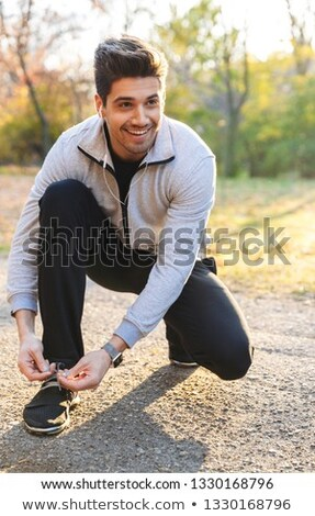 happy handsome young sportsman stock photo © deandrobot