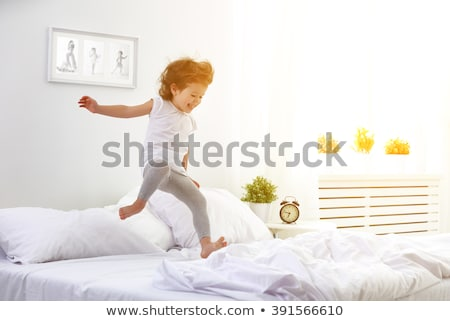 Children jumping on bed  Stock photo © bluering