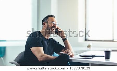 mature businessman at work in his office stock photo © minervastock