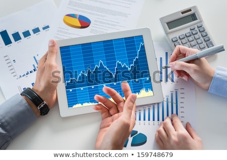 Businesspeople Discussing Graphs Stock photo © AndreyPopov