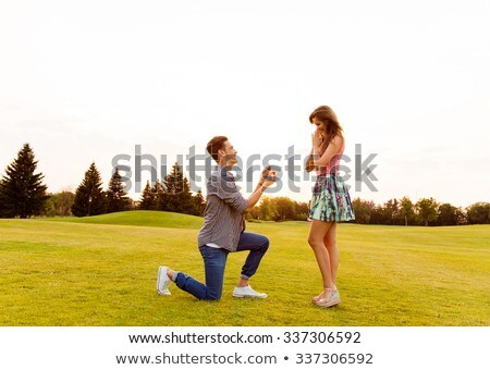 man propose to girl at sunset Stock photo © adrenalina
