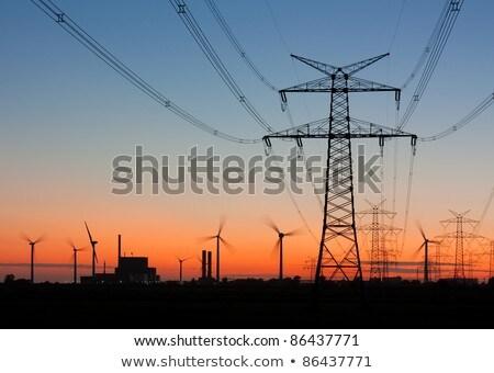 Távvezeték szélturbinák égbolt technológia farm ipari Stock fotó © elxeneize