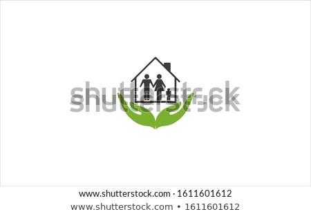 Mano casa residenza famiglia protezione Foto d'archivio © yupiramos